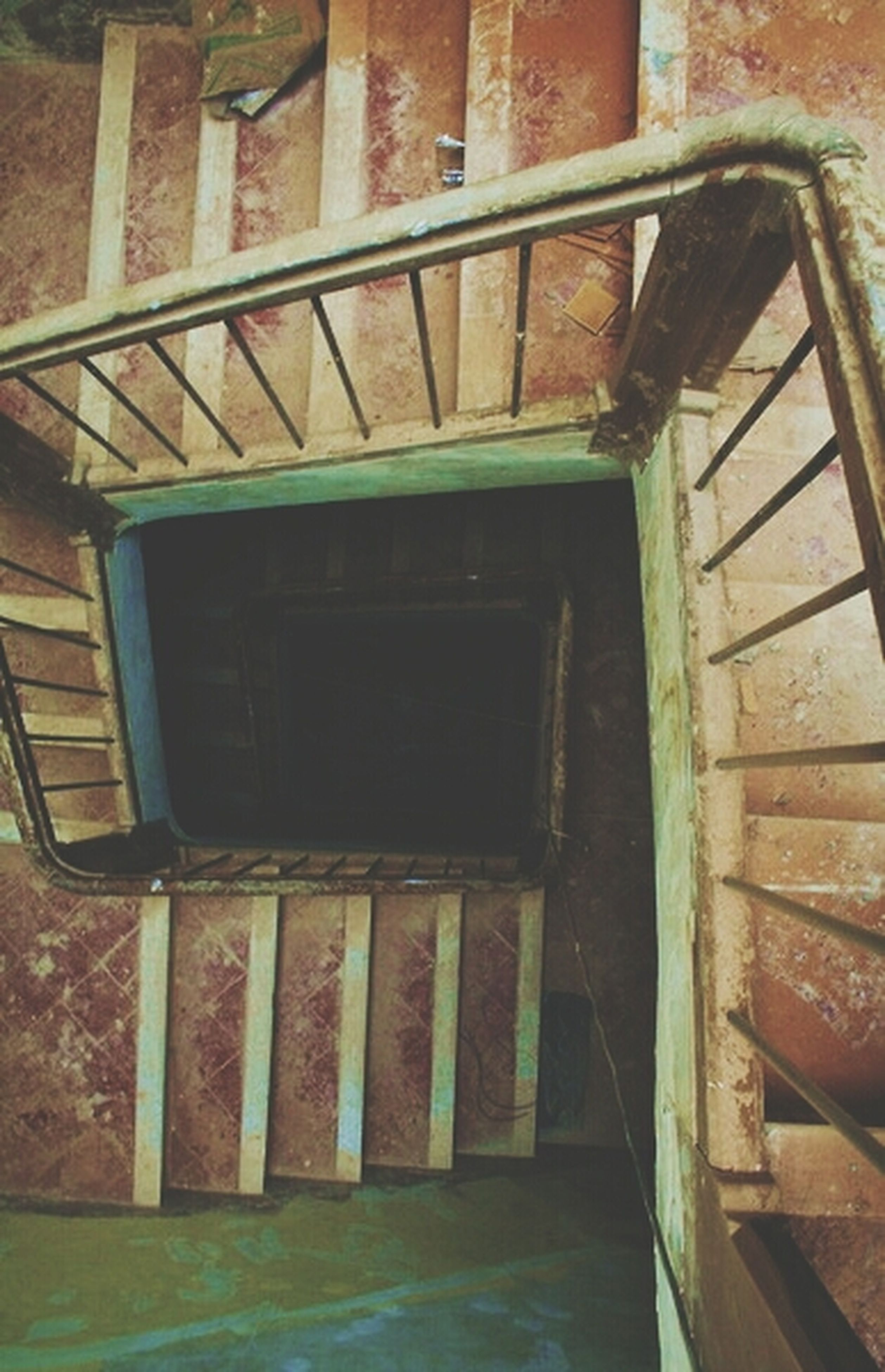 architecture, built structure, building exterior, railing, house, window, wood - material, old, steps, indoors, abandoned, staircase, steps and staircases, day, no people, low angle view, metal, building, residential structure, wooden