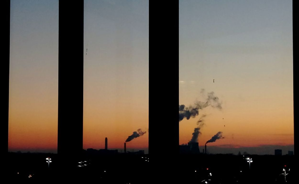 Air Pollution Built Structure Clear Sky Condensationtrail Day Distance View Emitting Environmental Issues Factory Fearoftheunknown Industry Nature No People Outdoors Power Plant At Night-extreme Style Power Station Silhouette Sky Smoke - Physical Structure Smoke Stack Social Issues Sunset Tranquil Scene Urban Landscape Urban Skyline