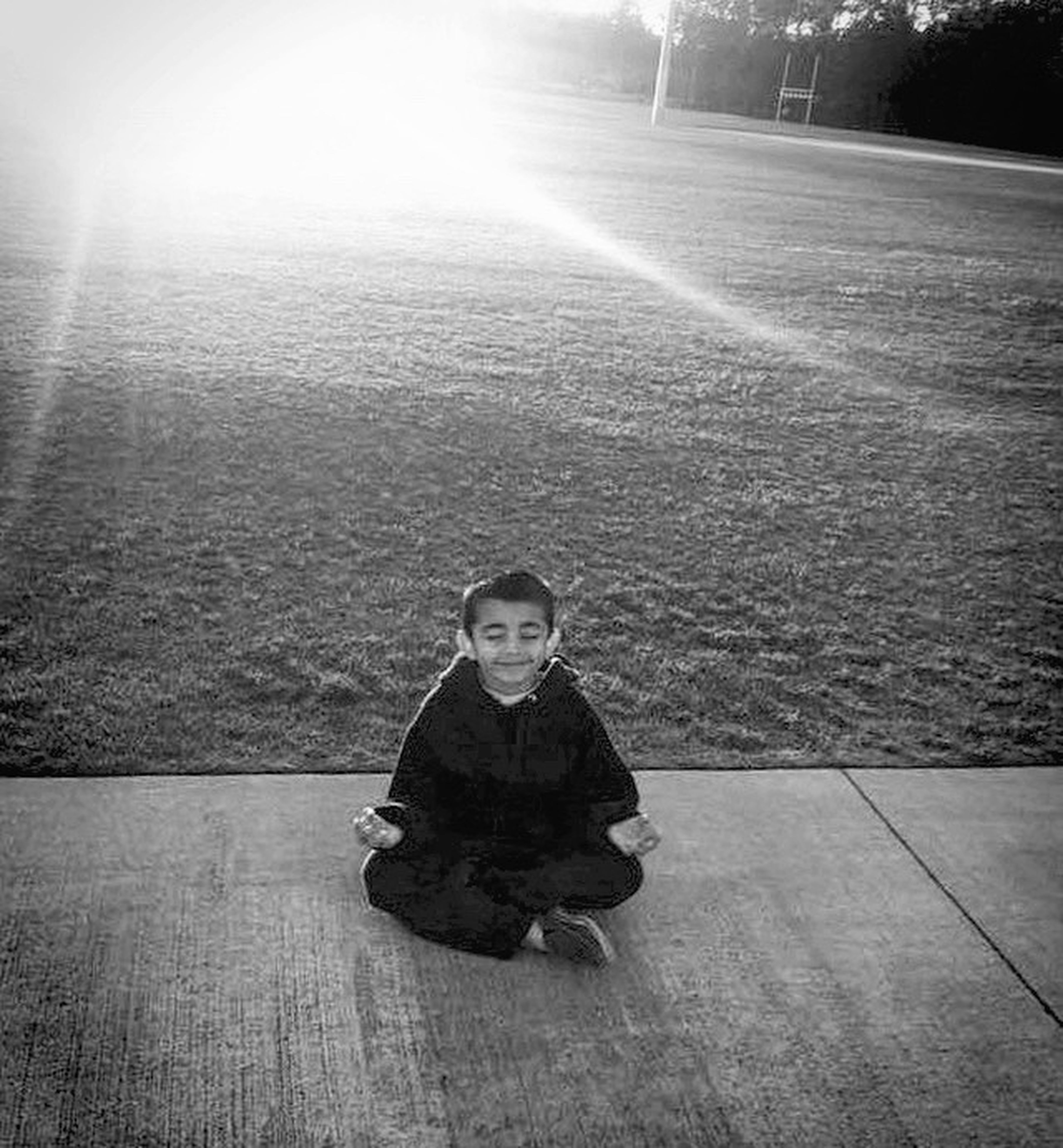 looking at camera, portrait, child, childhood, children only, one person, people, one boy only, outdoors, day, human body part, adult