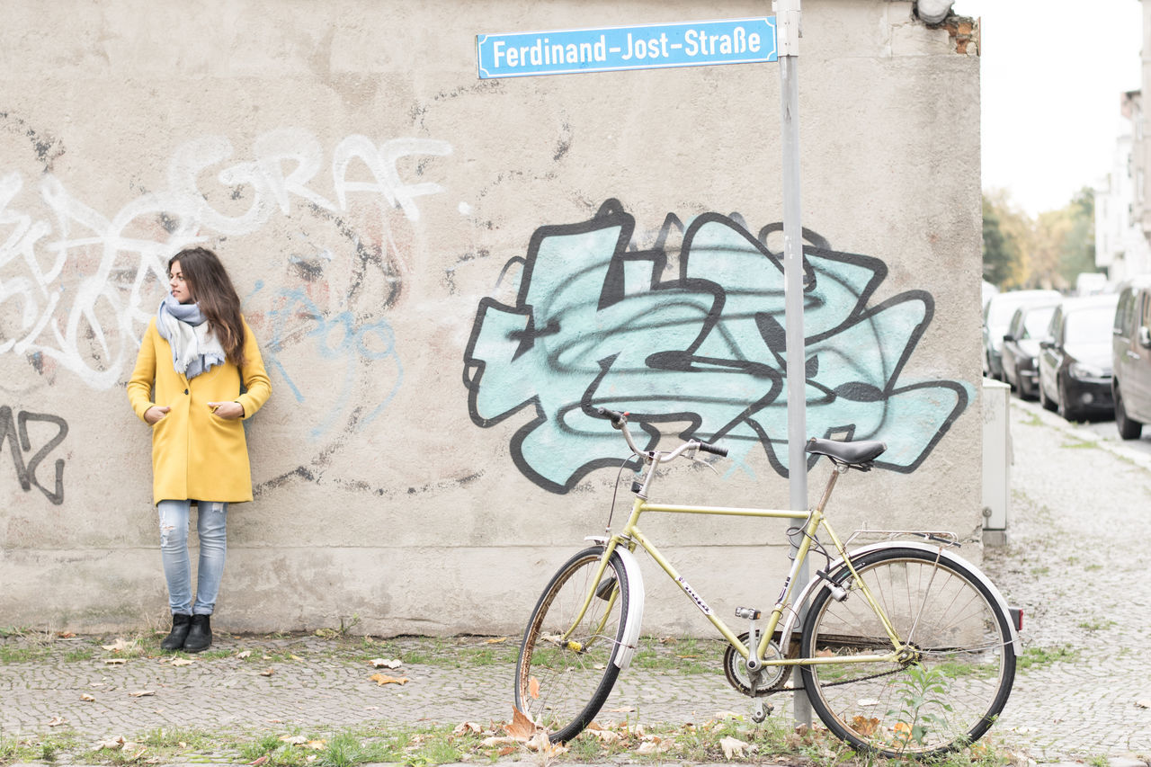 Pauline CyclingUnites Bicycle Bike Street Streetphotography Streetart Street Fashion Street Art Street Photography One Girl Only Girl Woman Female Femme Portrait Portrait Of A Woman Portrait Photography One Person Spray Paint Grafitti Outdoors Fashion Leipzig Sachsen Germany Women Around The World Art Is Everywhere The Portraitist - 2017 EyeEm Awards