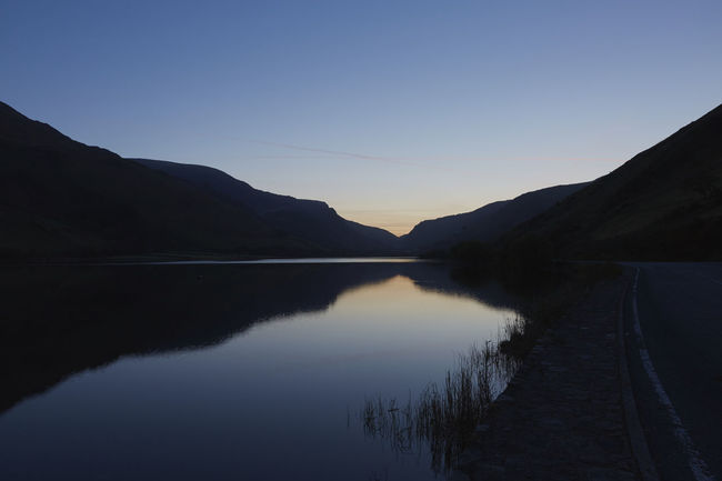 Blue Lake Landscape Mountain Mountain Range Nature No People Non-urban Scene Outdoors Reflection Sky Standing Water Sunrise Tranquil Scene Wales Water