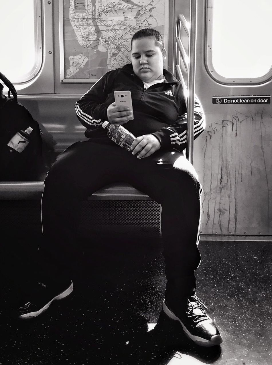 People Of New York Streetphotography Streetportrait Public Transportation Blackandwhite Bnw Mobilephotography Mpro Iphone6 Sitting Transportation Vehicle Interior Passenger Public Transportation Train - Vehicle Travel Full Length Journey Communication Wireless Technology Vehicle Seat Mode Of Transport Indoors  One Person Airplane Portable Information Device Mobile Phone Real People Young Adult