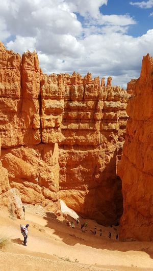 Navajo Loop Trail, Bryce Canyon National Park, Utah Ancient Bryce Canyon National Park Casual Clothing Cloud Cloud - Sky Day Famous Place Full Length Hiking Trail Hoodos Leisure Activity Lifestyles Nature Outdoors Rock - Object Rock Formation Sky Tourism Tourist Travel Destinations Utah Vacations