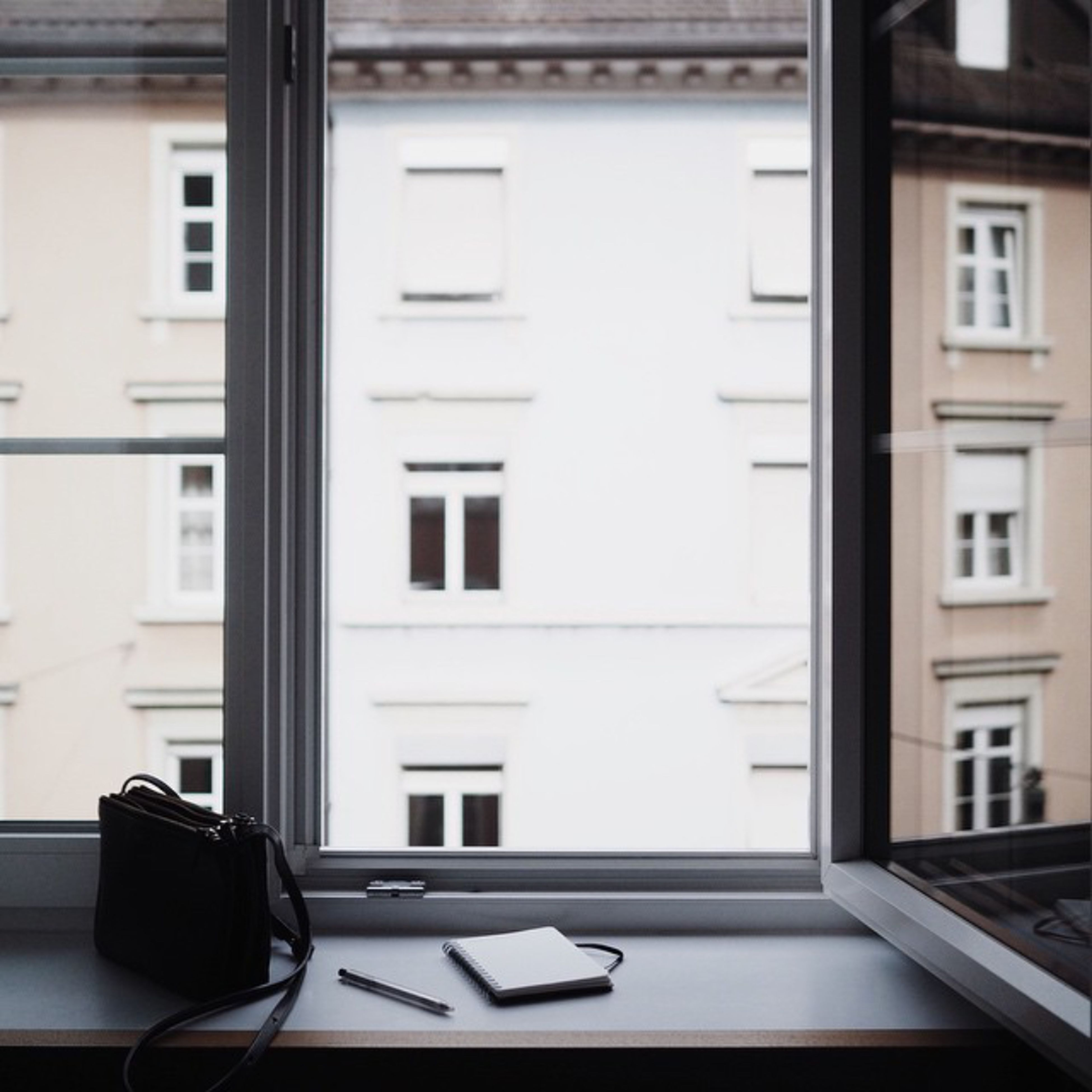 window, architecture, indoors, built structure, building exterior, residential building, chair, house, residential structure, balcony, absence, empty, no people, day, table, book, home interior, door, building, apartment