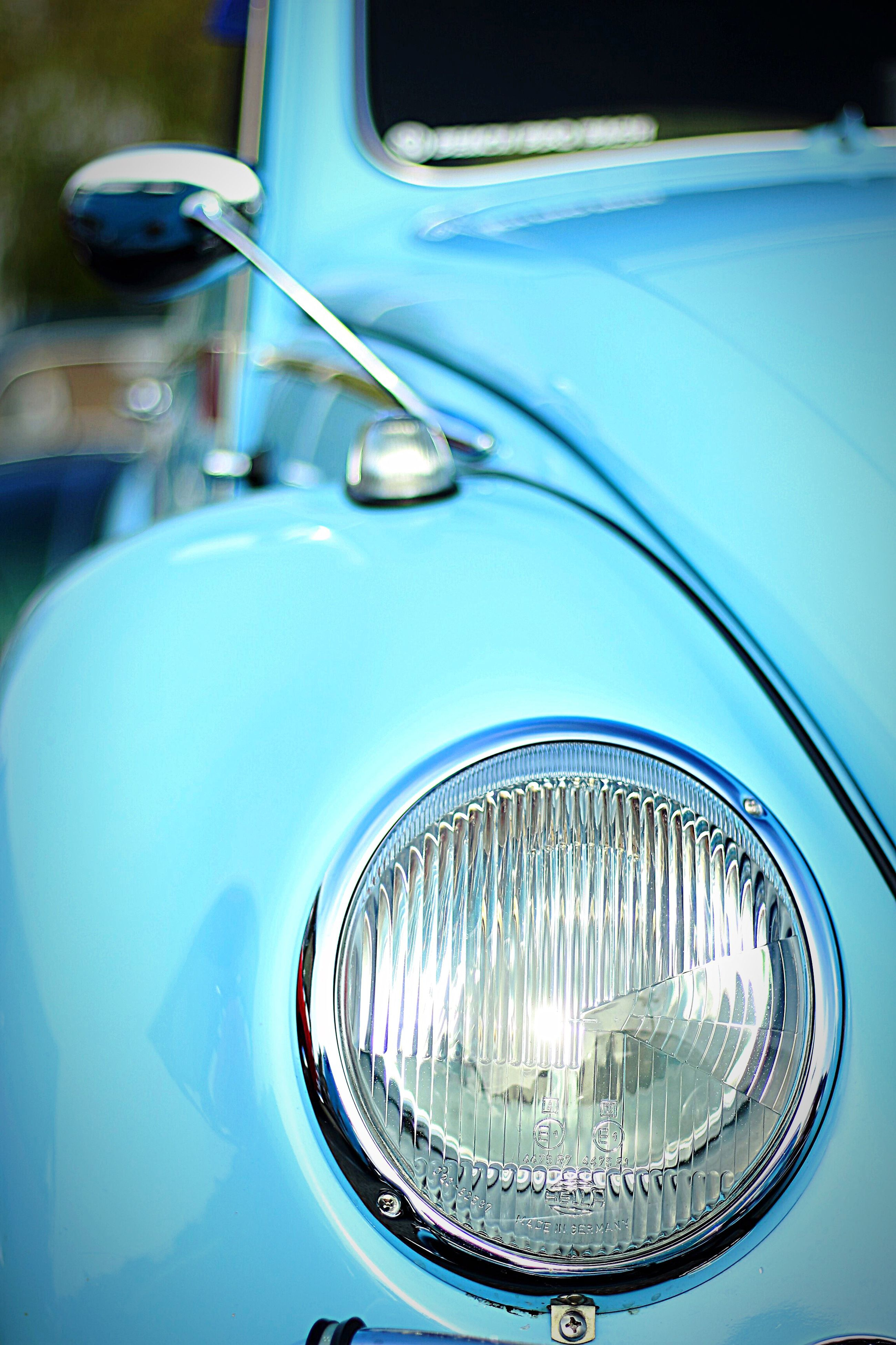 car, mode of transport, transportation, headlight, land vehicle, vintage car, luxury, reflection, outdoors, no people, day, blue, close-up