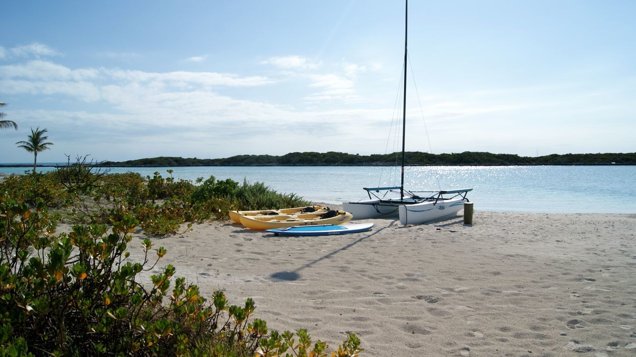 Nautical Vessel Beach Sea Water Sky Sand Tranquil Scene Day Tranquility Nature Outdoors Cloud - Sky Tree Scenics Landscape No People Travel Destinations Beauty In Nature Horizon Over Water Kayak Catamaran Surf Paddleboard