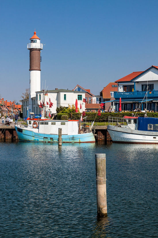 Port in Timmendorf on the island Poel. Architecture Building Exterior Built Structure City Clear Sky Day Fishing Boat Flag Harbor Harbor Lighthouse Mode Of Transport Moored Nautical Vessel No People Outdoors Poel Port Sailing Ship Sky Timmendorf Tower Transportation Travel Destinations Water