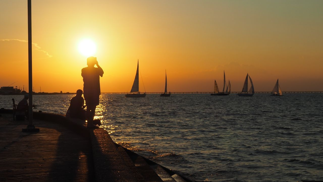 Lakeshore, New Orleans Lakeshore Nautical Vessel Orange Outdoors Sailboats Scenics Sea Silhouette Sunset Warm Water First Eyeem Photo