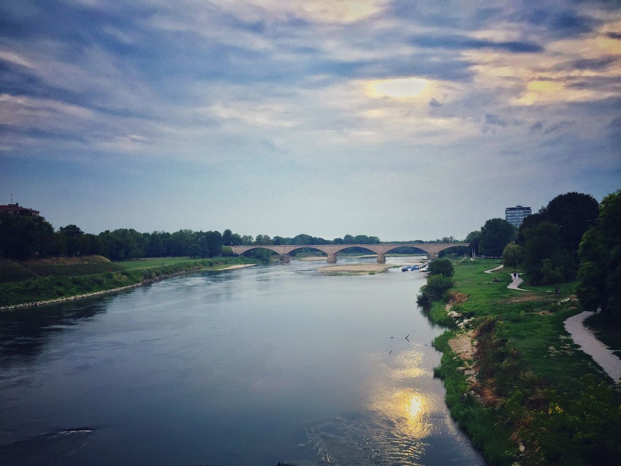 sky, water, cloud - sky, river, scenics, reflection, no people, outdoors, tree, beauty in nature, nature, tranquil scene, architecture, built structure, day, landscape