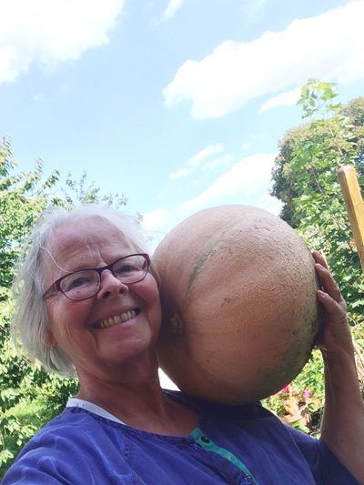 My 8 kilo pumpkin harvest Eyeglasses  Looking At Camera Real People Day Portrait Outdoors Smiling Senior Adult Leisure Activity One Person Headshot Happiness Sky Tree Nature Pumpkin Harvest Gardening Healthy Lifestyle Healthy Eating