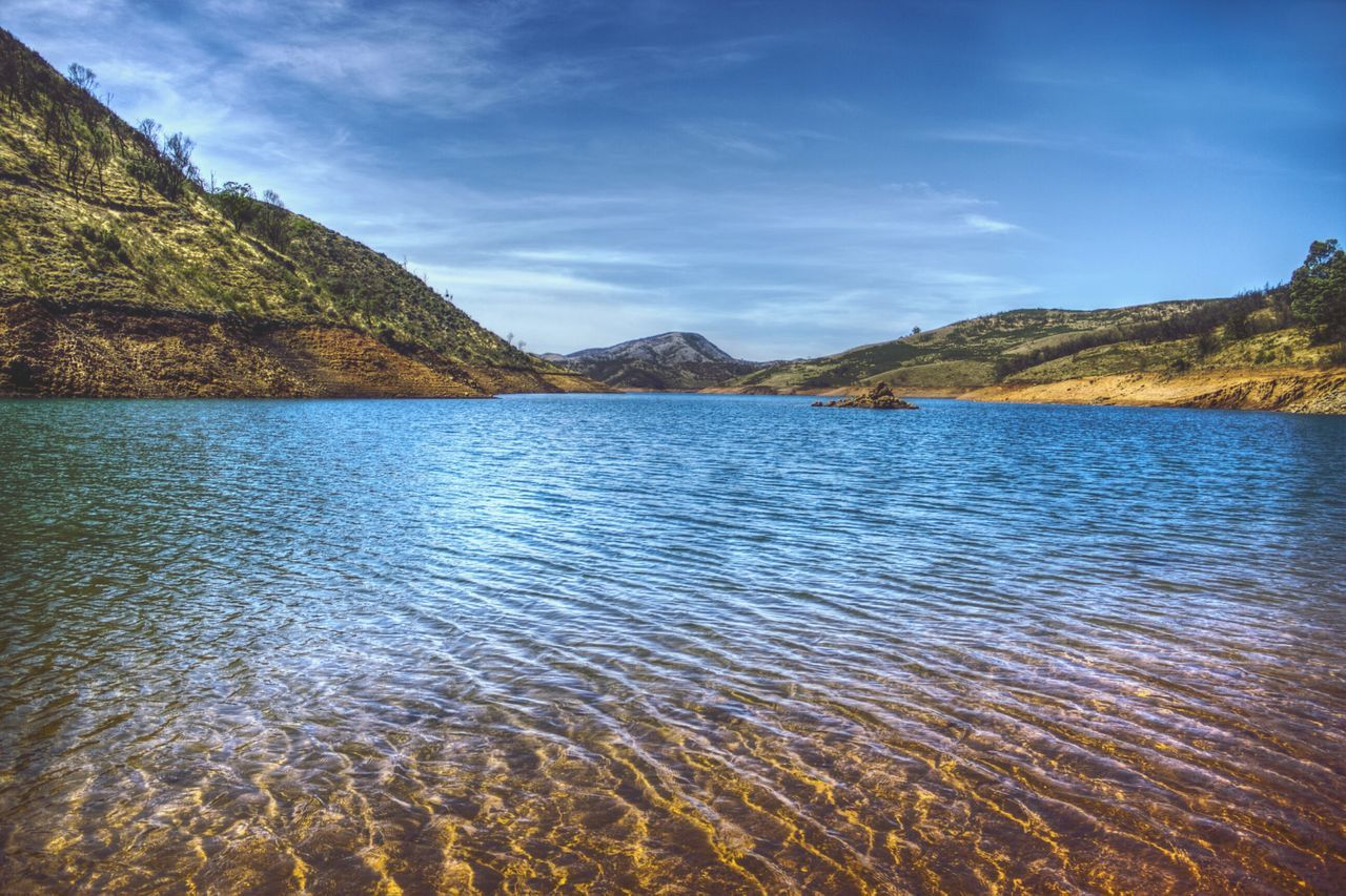 lake, scenics, nature, tranquility, rippled, beauty in nature, water, tranquil scene, mountain, no people, outdoors, remote, waterfront, idyllic, day, mountain range, landscape, sky