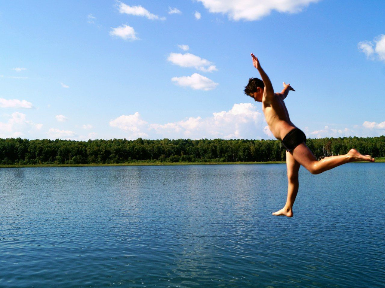 Flight by air boy on lake Danilino Beauty In Nature Blue Boy Flight By Air Lake Lake View Nature One Person Summer Water
