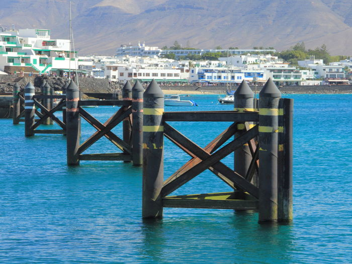 Hafenanlagen - docks - dársena Architecture Beauty In Nature Building Exterior Built Structure Darsena Day Docks Hafenanlagen Harbor Lanzarote-Canarias Nature No People Outdoors Pier Sea Sky Tranquility Water