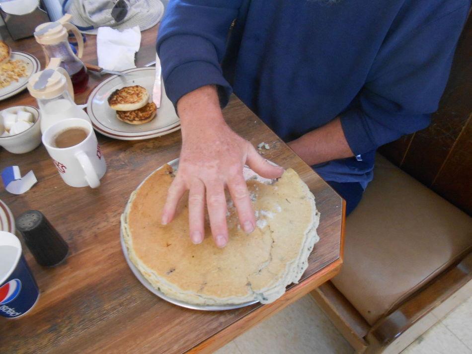 Huge pancake for breakfast B Close-up Food Food And Drink Giant Pancake Human Body Part Human Hand Indoors  Pancakes Temptation Wyoming