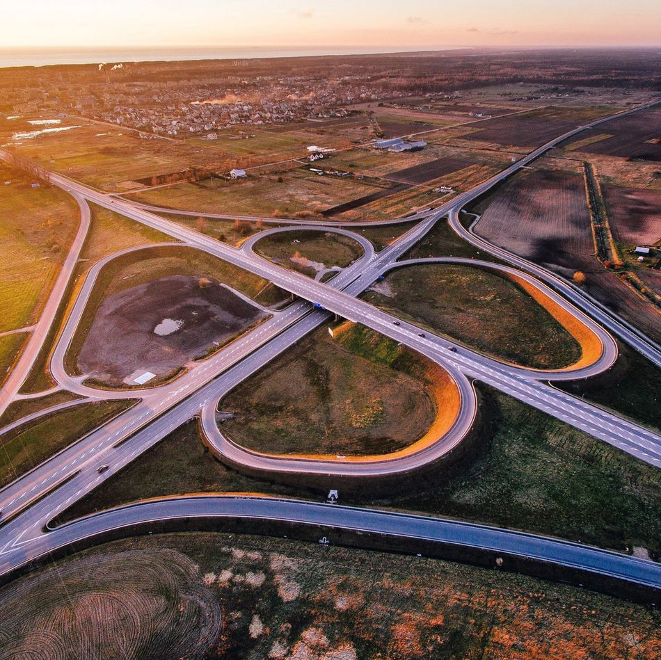 Aerial View Transportation Road Connection Highway Landscape Outdoors High Angle View Scenics No People Travel Destinations Nature Bridge - Man Made Structure Tranquility Beauty In Nature Day Airplane Flying City Sky