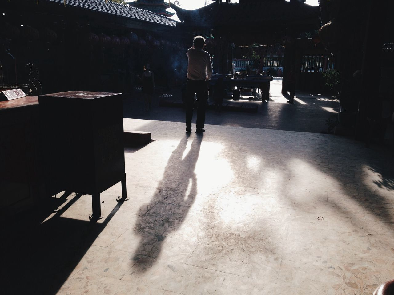 full length, one person, real people, shadow, standing, men, rear view, one man only, sunlight, built structure, lifestyles, day, architecture, indoors, only men, adult, people