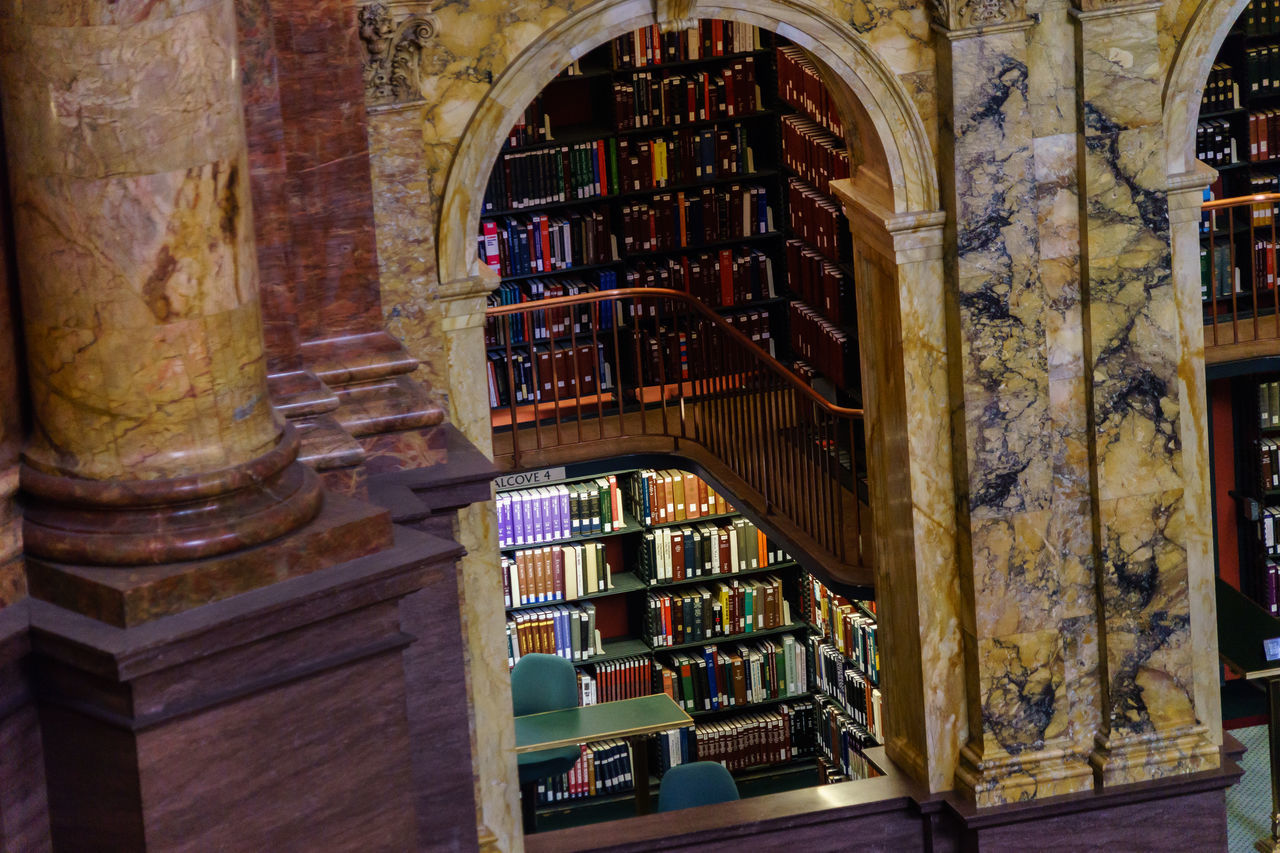 book, bookshelf, library, indoors, architecture, shelf, architectural column, no people, built structure, day