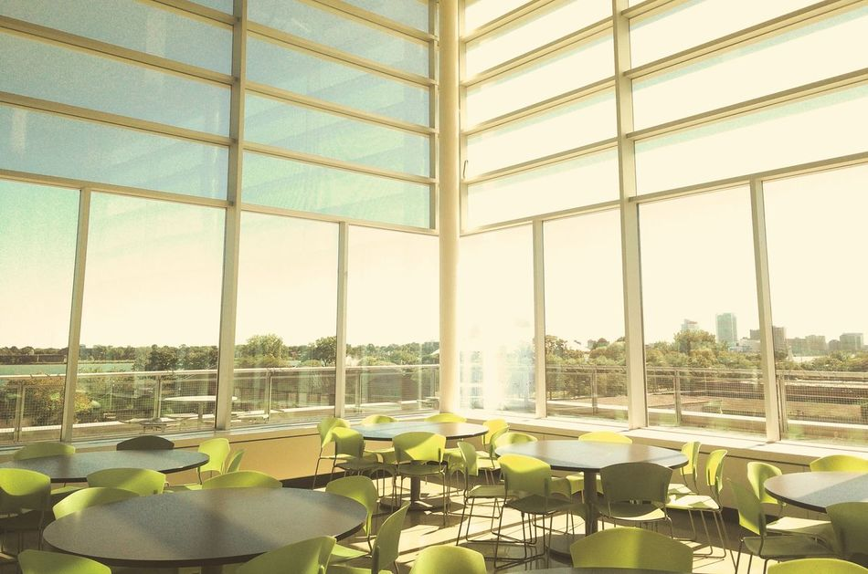 The Color Of School Chair Indoors  Window School Cafeteria Arrangement Sky Absence Place Setting Table Sunshade