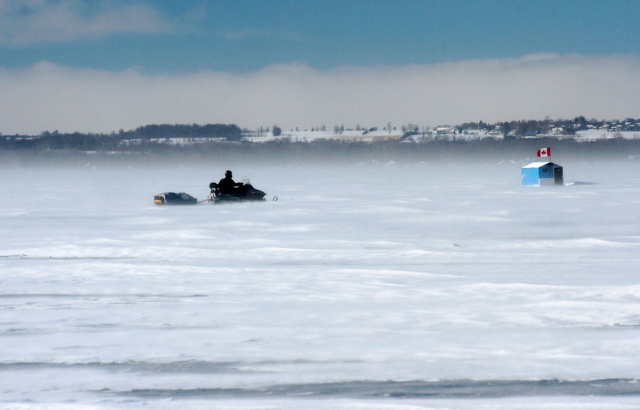 Cold trip to the ice fishing hut on snowmobile Blizzard Conditions Cold Temperture Escapism Frozen Lake Frozen Lake, Getting To The Ice Hut Ice Fishing Selective Focus Snowmobile Lake Simcoe