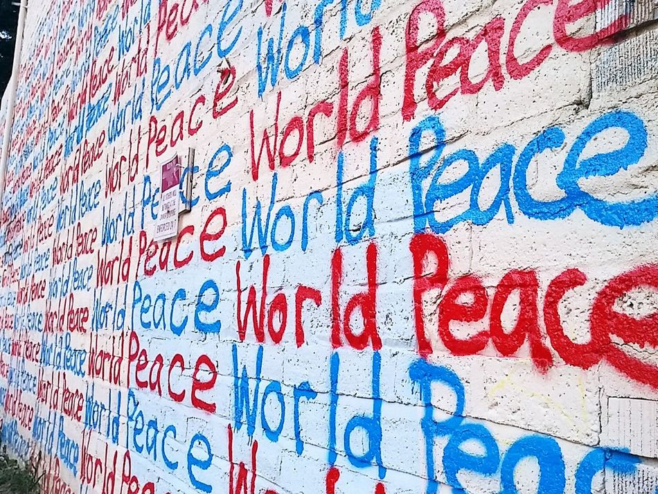 Blue Red Close-up Peace World Peace Graffiti Art Graffiti Wall Graffitiart Graffitiwall Graffitti Graffiti Wall Painting/grafitti Painted Brick Art Message Asheville, NC Asheville Asheville Nc