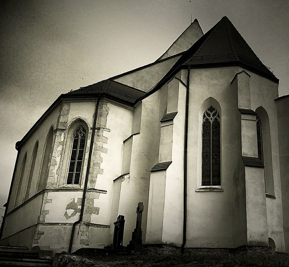 Architecture Blackandwhite Photography Building Exterior Built Structure Chapel Church Church Clear Sky Darkness And Light Exterior Façade Gothic Gothic Church Gravestones Historic History Memories Religion Sky Spirituality Window