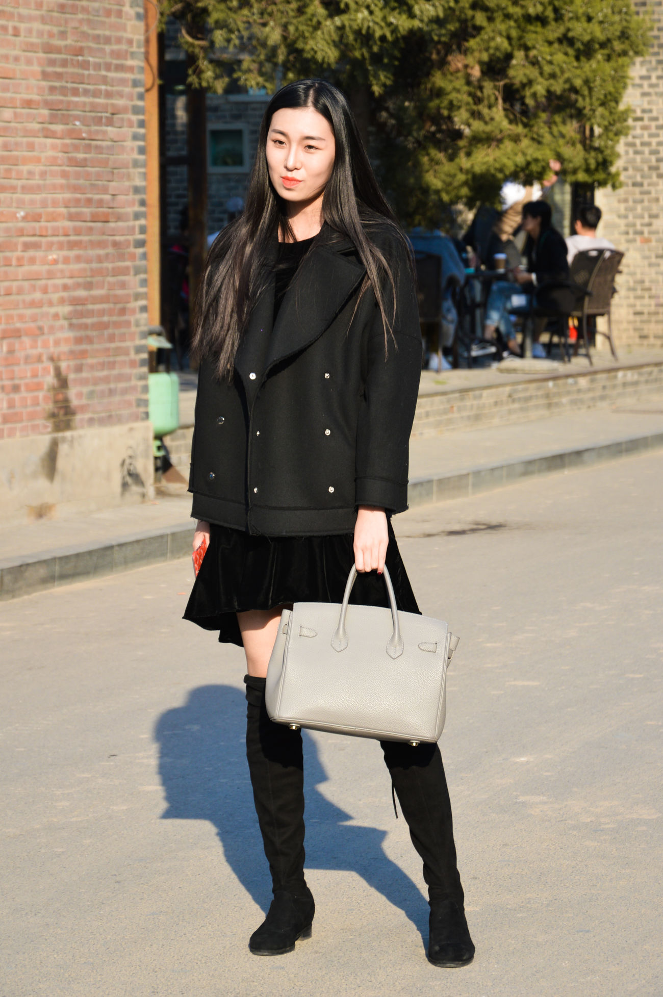 Adult Adults Only Arts Culture And Entertainment Day Fashion Full Length Jacket Leather Leather Jacket Long Hair One Person One Woman Only One Young Woman Only Only Women Outdoors People Portrait Real People Smiling Warm Clothing Young Adult Women Around The World