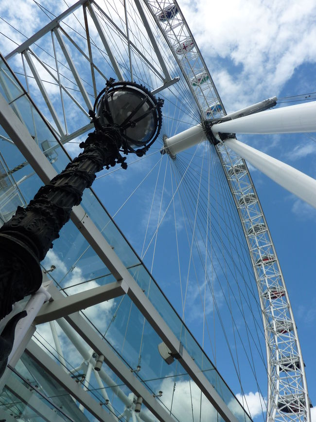 The London Eye on a summer's day Architecture Big Wheel Built Structure Cloud - Sky Day Ferris Wheel Lamp Post London Eye Low Angle View Neighborhood Map No People Outdoors Sky Travel Destinations The Architect - 2017 EyeEm Awards Thames South Bank EyeEm LOST IN London