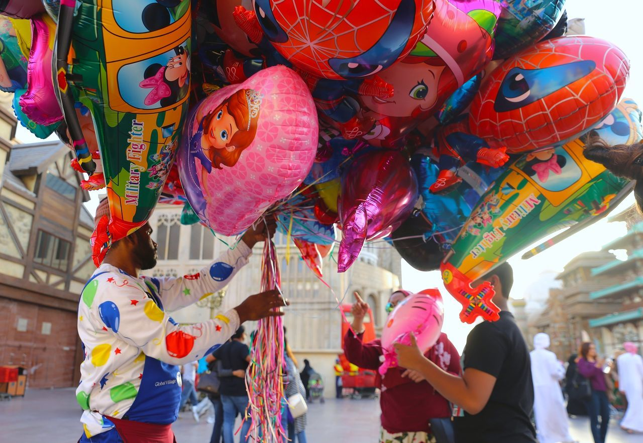 Balloon Carnival - Celebration Event Celebration Cultures Day Hanging Helium Balloon Men Multi Colored Outdoors People Street Dubai Global Village Dubai UAE , Dubai