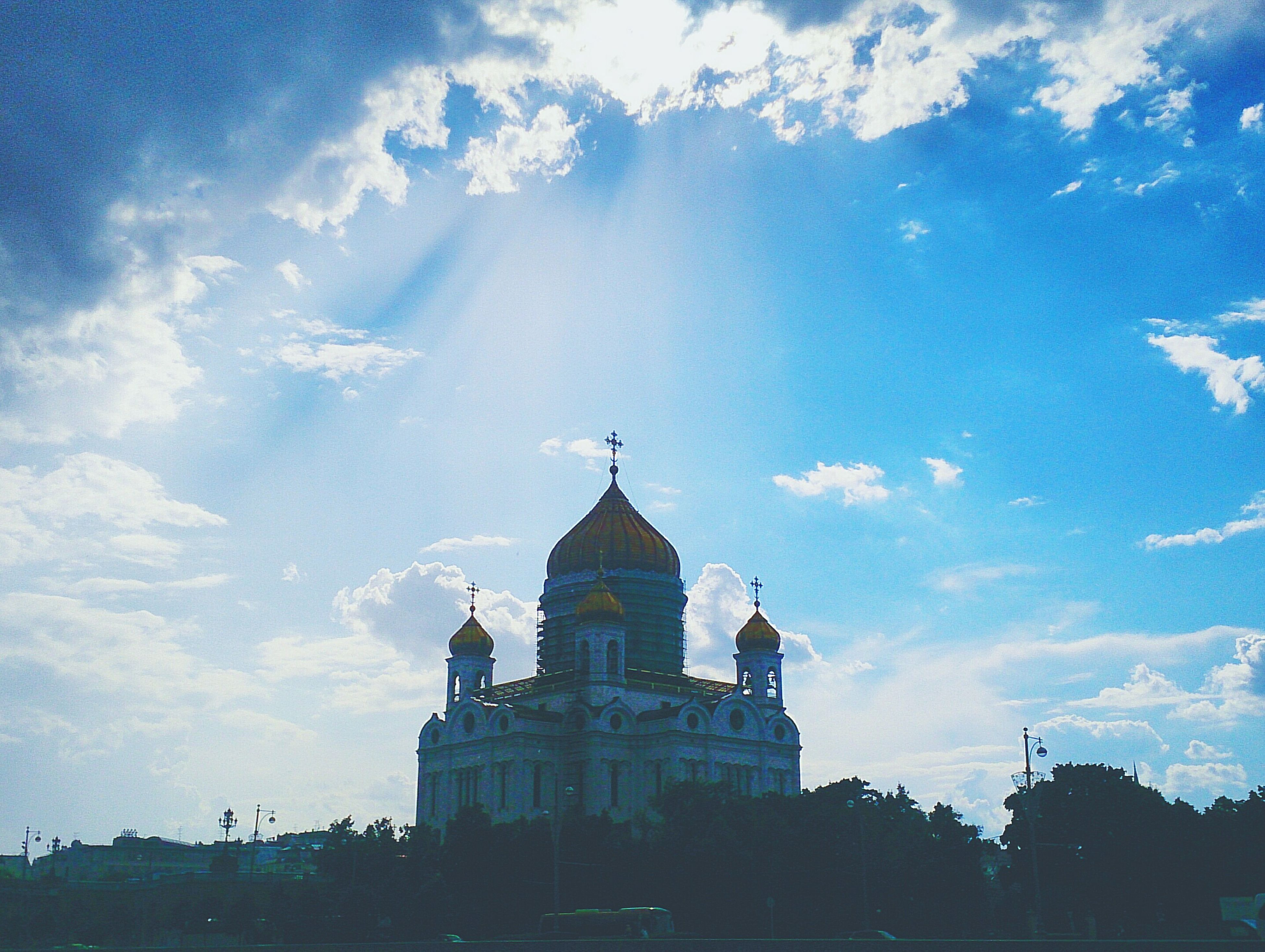 building exterior, architecture, built structure, religion, church, place of worship, spirituality, sky, cathedral, cloud - sky, low angle view, dome, cloud, cross, blue, history, silhouette, outdoors