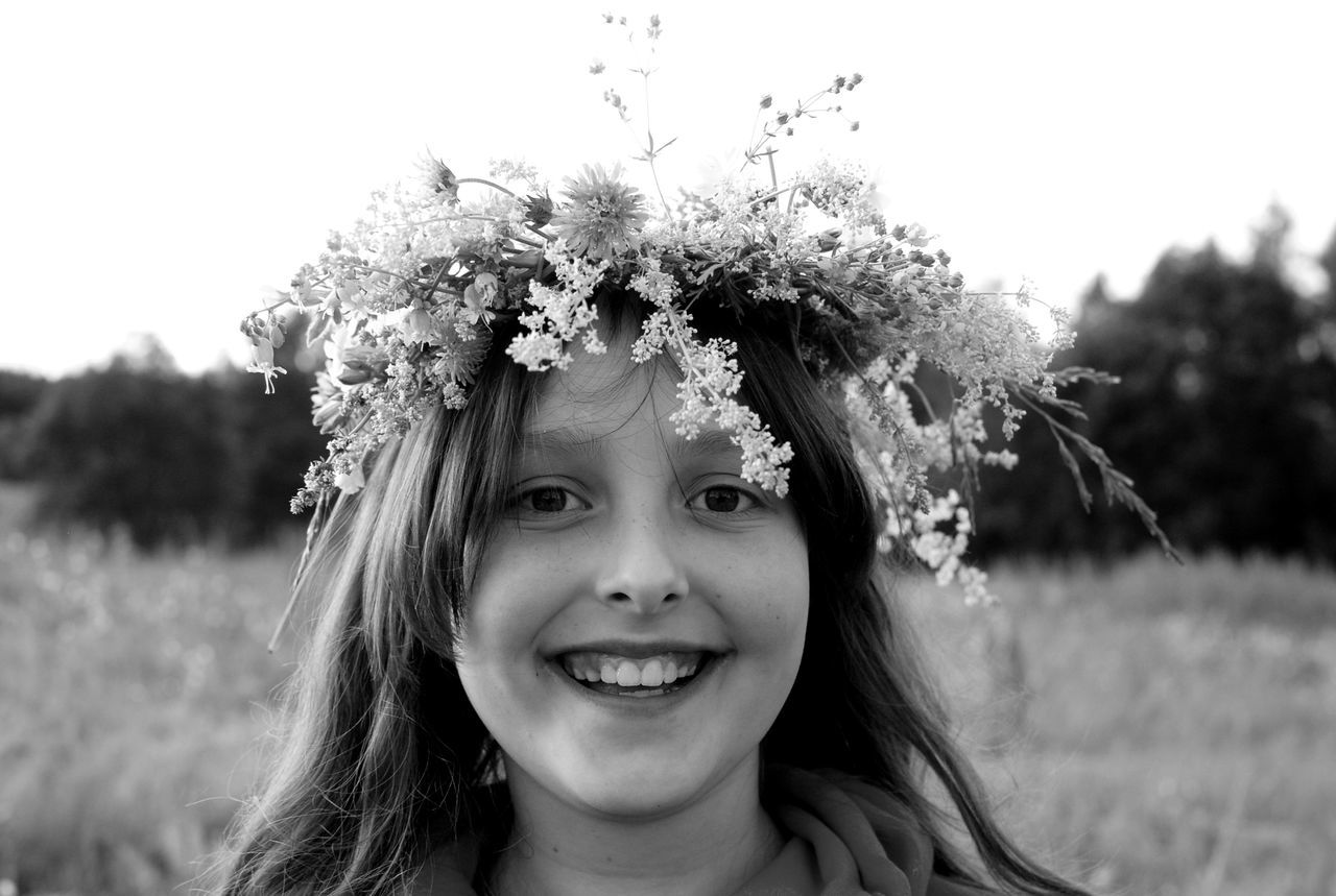 Childhood Close-up Elementary Age Flower Happiness Headshot Lifestyles Looking At Camera Nature One Person Outdoors Portrait Real People Smiling Live For The Story