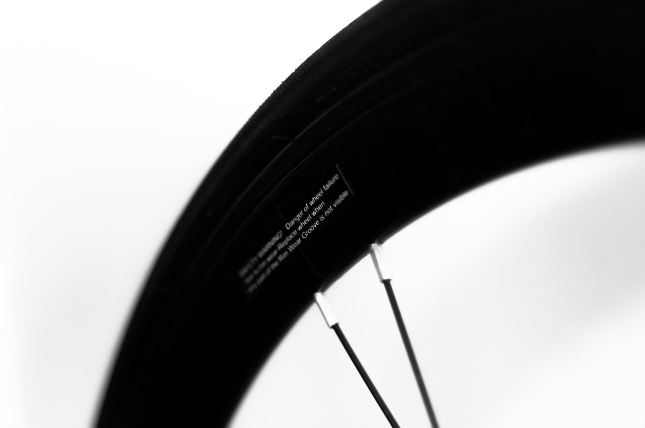 Bicycle Front Wheel with Warning Sticker Aero Aerodynamic Background Deep Depth Fixedgear Fixie Front Isolated Profile Rim Singlespeed Sticker Tire Tyre Warning Wheel