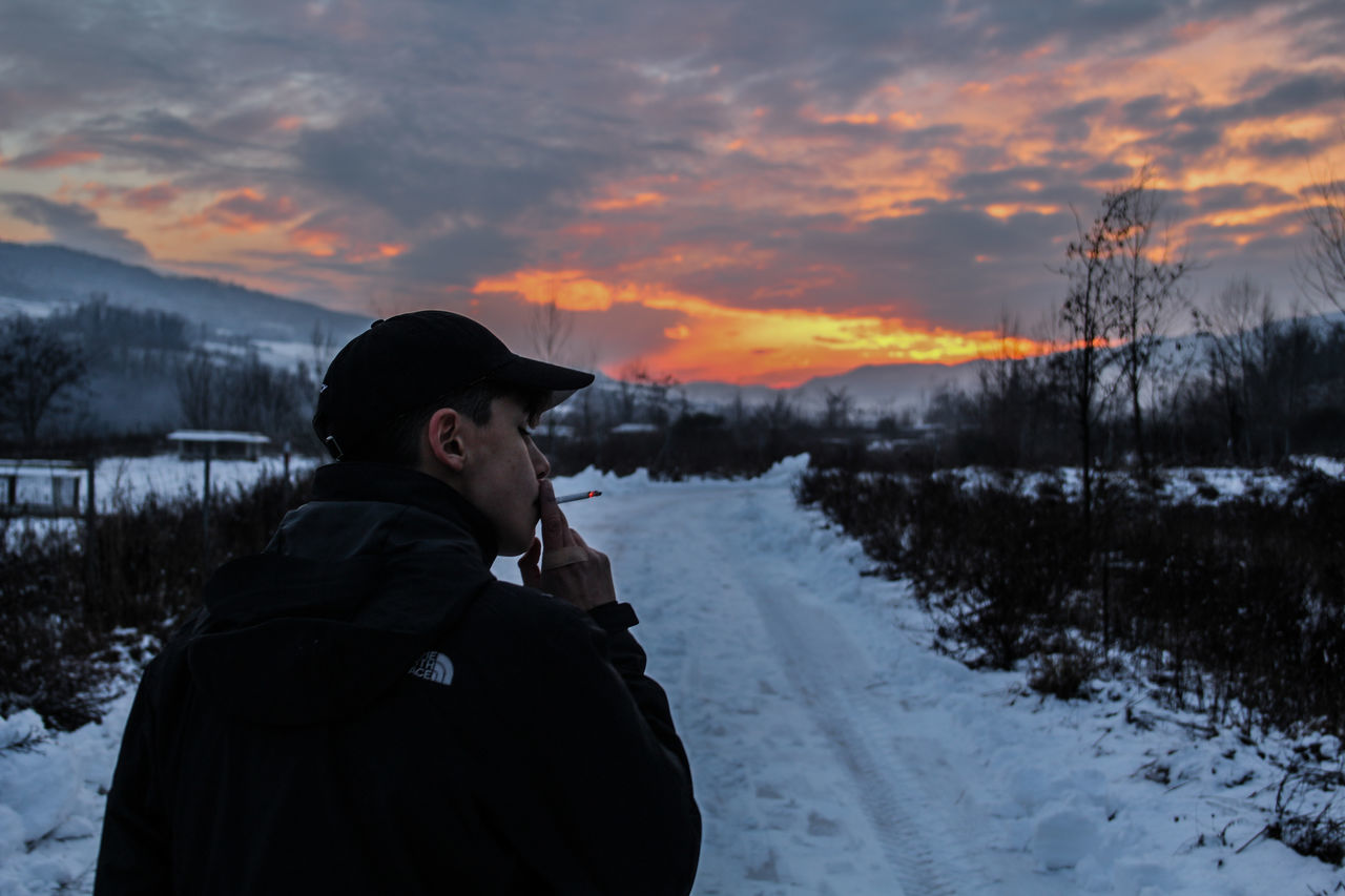 exhale Winter One Person Snow Cold Temperature Sunset Beauty In Nature One Man Only Nature Warm Clothing Only Men People Sky Adults Only Outdoors Adult Day Friends Photography Photographer Sunset Cigarette  Cigarette Time Pale GrungeStyle Grunge