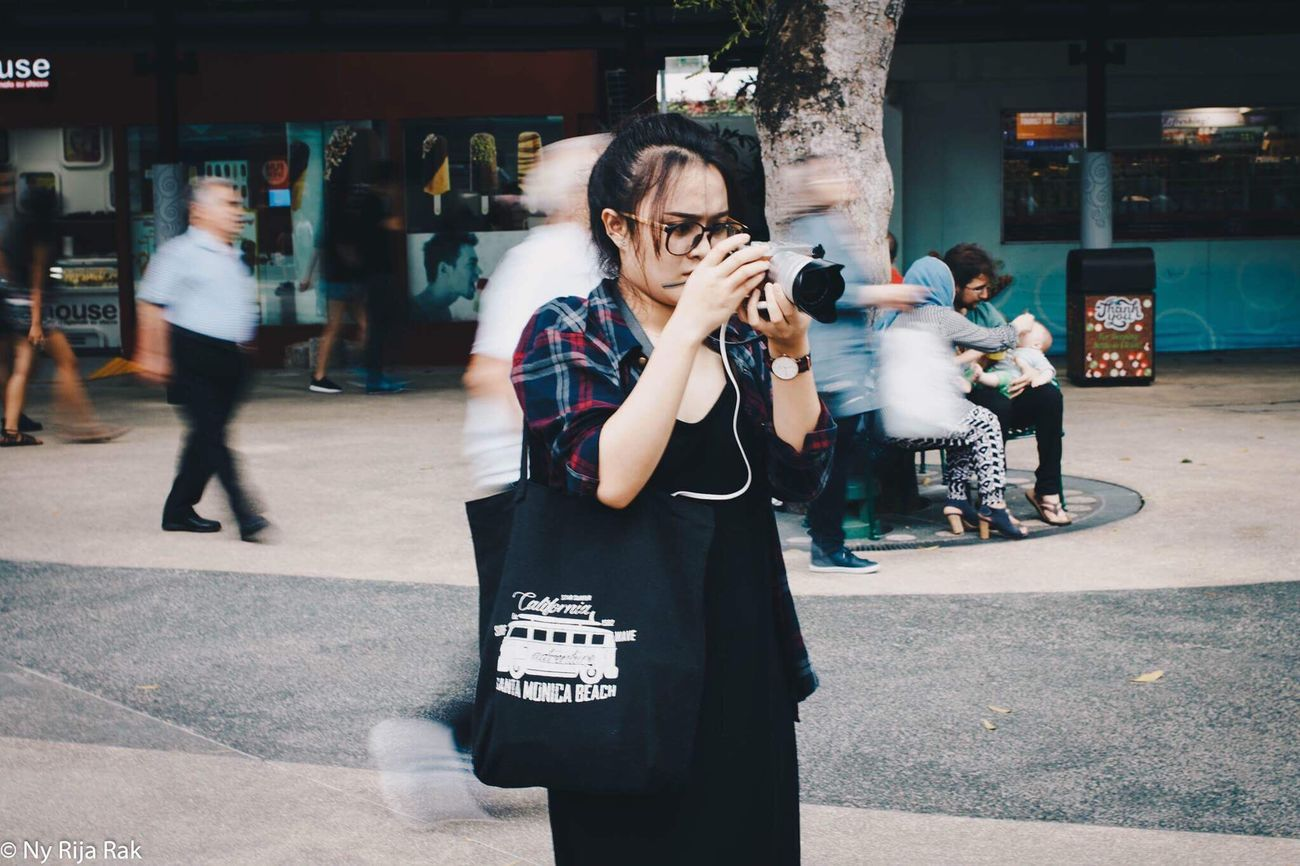 Photography Themes Camera - Photographic Equipment Photographing Real People People Outdoors Adults Only Day Photographer Adult Blur Streetphotography Movement Crowded One Woman Only Lifestyles