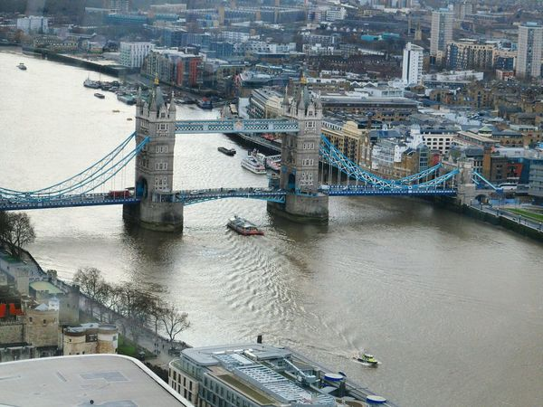 Tower Bridge and the River Thames Architecture River Thames River London - England No People Outdoors Uk Aerial View Aerial Photography Capital Cities  Capital City Cityscapes City Famous Place Elevated View Looking Down Aerial Shot River View Boats Historical Place Travel Destinations Connection Travel Historical Building International Landmark
