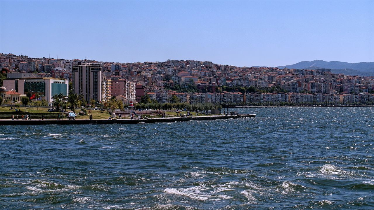 Ferry time🛳🛳 Battle Of The Cities My Favorite Place Turkey Turkey Izmir Hanging Out First Eyeem Photo Landscape Architecture Building Exterior Built Structure Water City Waterfront Clear Sky Residential Building Residential Structure Blue Sea Cityscape Residential District River Outdoors Mountain Town Day