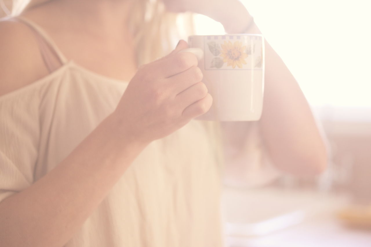 Morning coffee and soft light through the window. Atmosphere Atmospheric Mood Beautiful Light Beauty Coffee Day Dreamy Drink Drinking Food And Drink Holding Lifestyles Love Misty Morning One Person People Soft Focus Softness Sunlight Tea Warm Woman Women Yellow