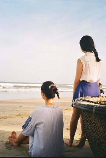 Film Film Photography Filmisnotdead Capture The Moment Afternoon Travel Vietnam Da Nang Mykhebeach Sitting Take A Break Sea Relaxing Two People Casual Clothing Women Sky Vacations Holiday Boat Nature Friends Beach Rear View