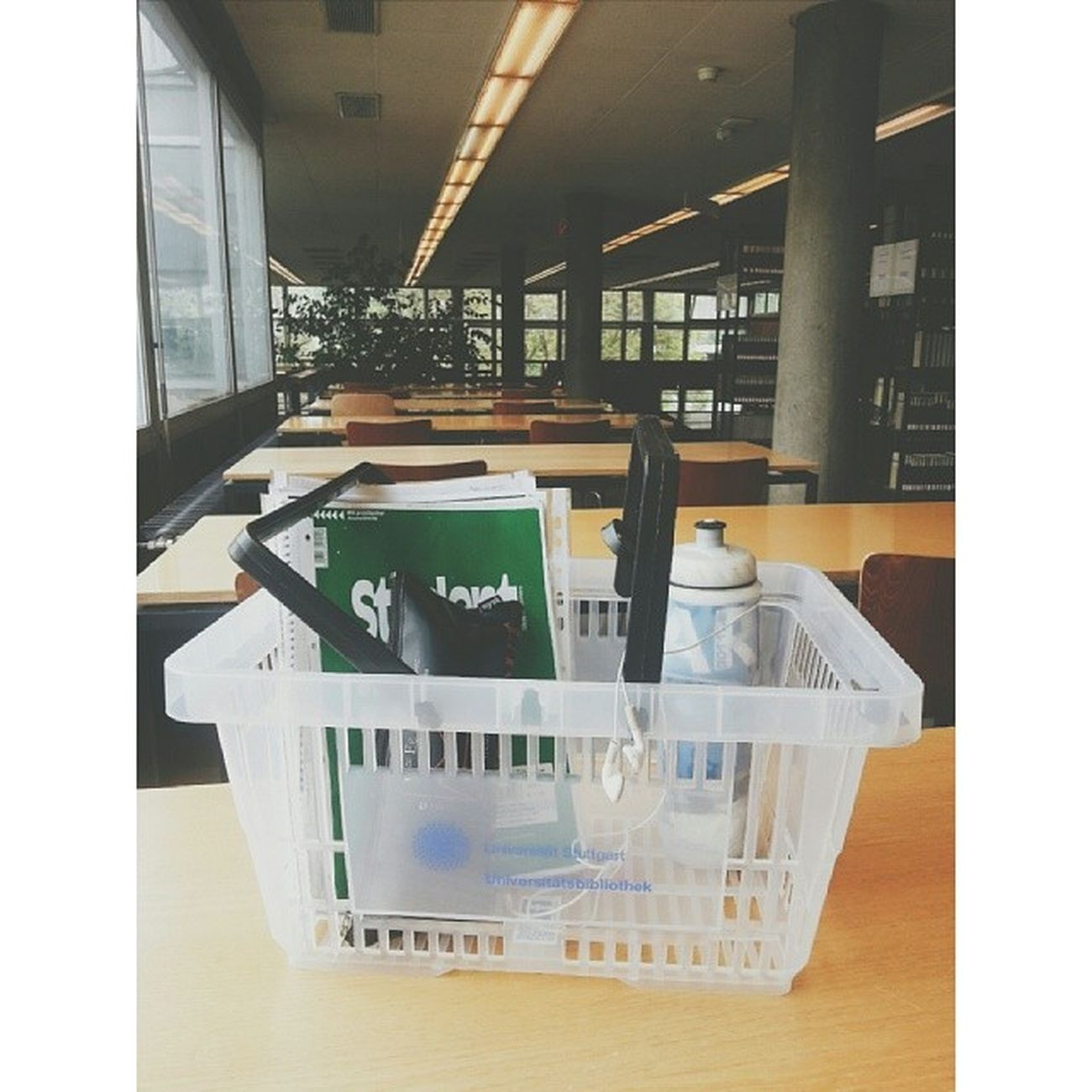 Waiting for my next class in the library and no bags are allowed. So we have to put our belongings inside a grocery basket. :) Uniquedeutschland