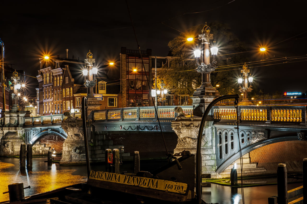 Boat and bridge Amsterdam Architecture Bridge - Man Made Structure Building Exterior Built Structure City City Holland Illuminated Lantern Long Exposure Mode Of Transport Nautical Vessel Netherlands Night No People Outdoors Reflection Sky Street Light Transportation Water
