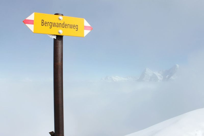 Road Sign Outdoors Swiss Mountains Switzerland Alps Mountains Schweizer Alpen Schweiz 🇨🇭, Lanscape Photography Nature Photography Landscape_photography Bernese Oberland Switzerlandpictures Schweiz Cold Temperature Winter Switzerland Piz Gloria Top Of Europe HJB Way Way To Go Clouds And Sky
