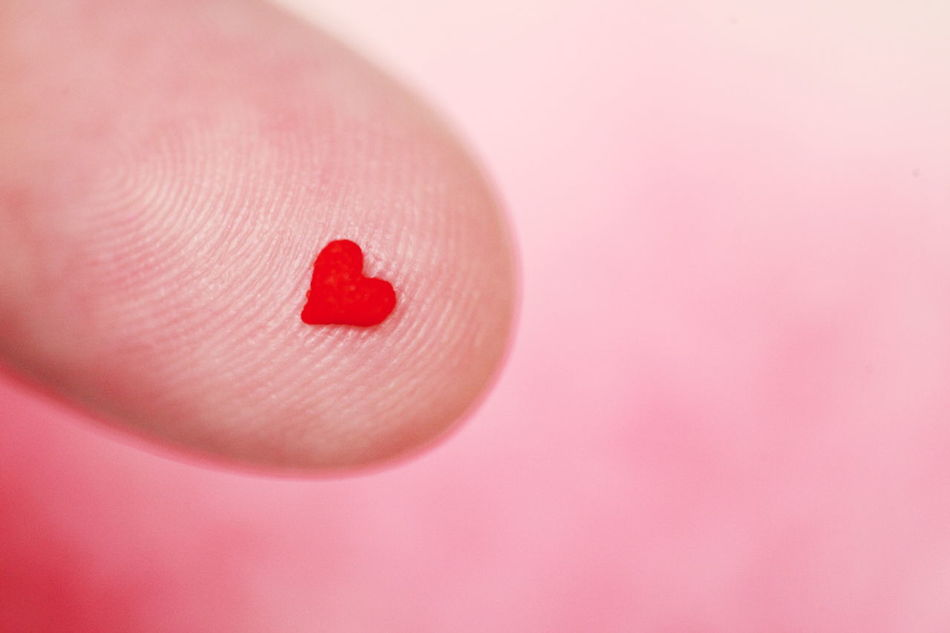 My finger and a tiny heart shaped candy. Amor Amour Be Mine Candy Close-up Colorful Copy Space Cute Fingers Food Heart Hearts Love Macro One Person People Pink Red Romance Romantic Sweet Tiny Valentine Valentine's Day