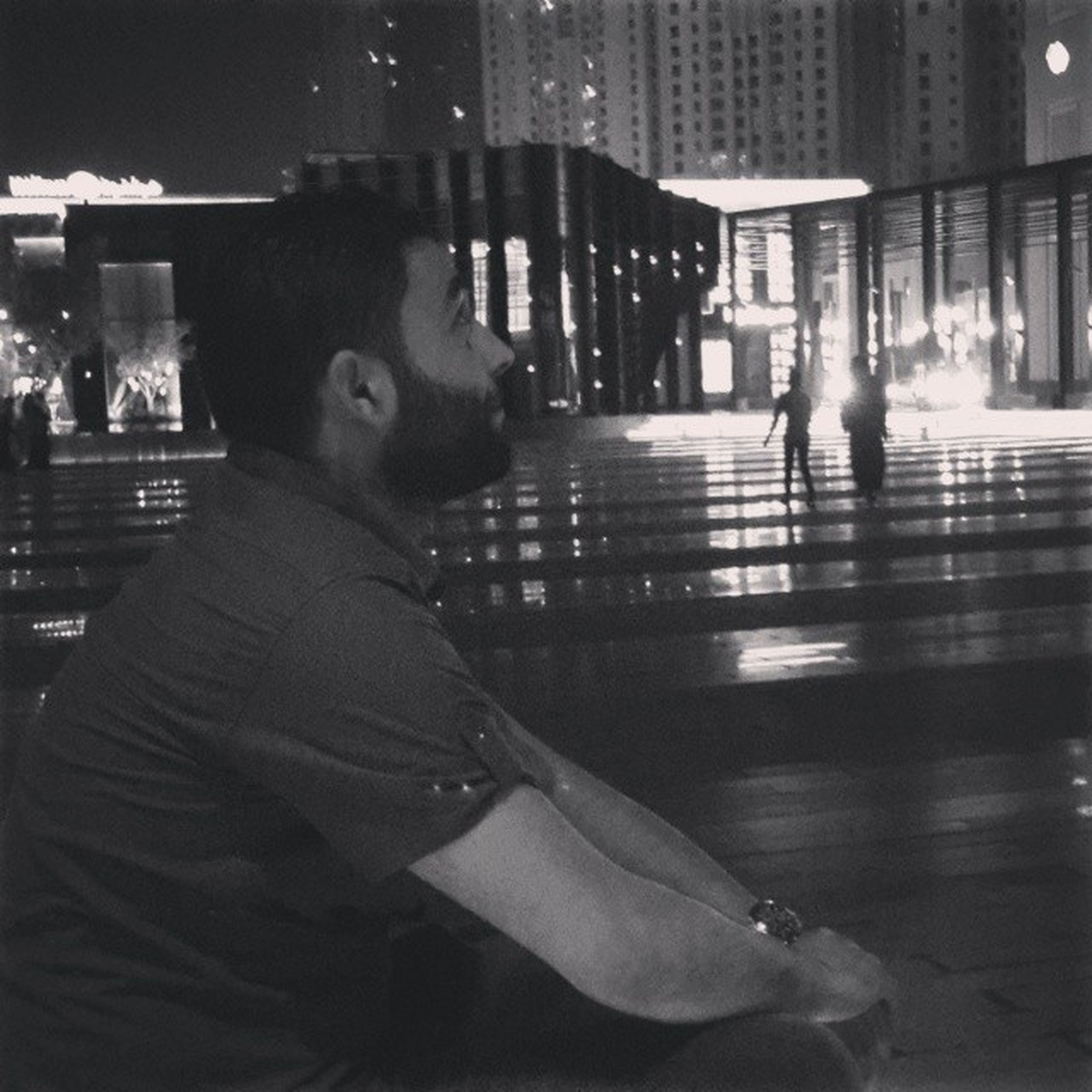 lifestyles, building exterior, architecture, built structure, night, leisure activity, men, city, person, illuminated, city life, rear view, walking, full length, incidental people, casual clothing, focus on foreground, standing