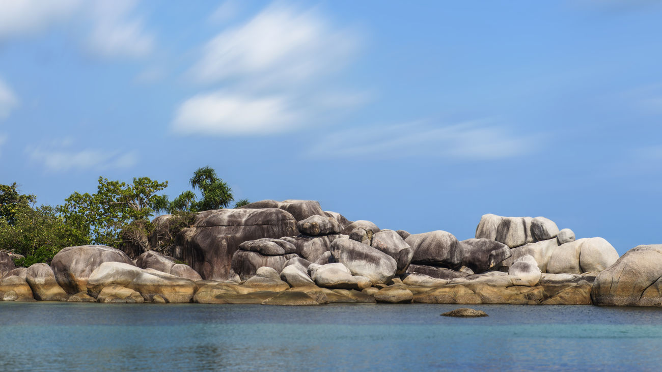 Scenic sea stack against a bright blue sky in Belitung Island, Indonesia. It is one of iconic shooting location of Indonesian Box-Office film Laskar Pelangi Beach Beach Day Beach Photography Belitung Island Belitung, Indonesia Blue Sea Blue Sky Day Idyllic Scenery Landscape Nature No People Outdoors Rock - Object Rock And Sea Rock And Water Rock Formation Rock Formations Rock Stacking Rocky Mountains Scenery Shots Scenic Landscapes Scenic Lookout Sea Water