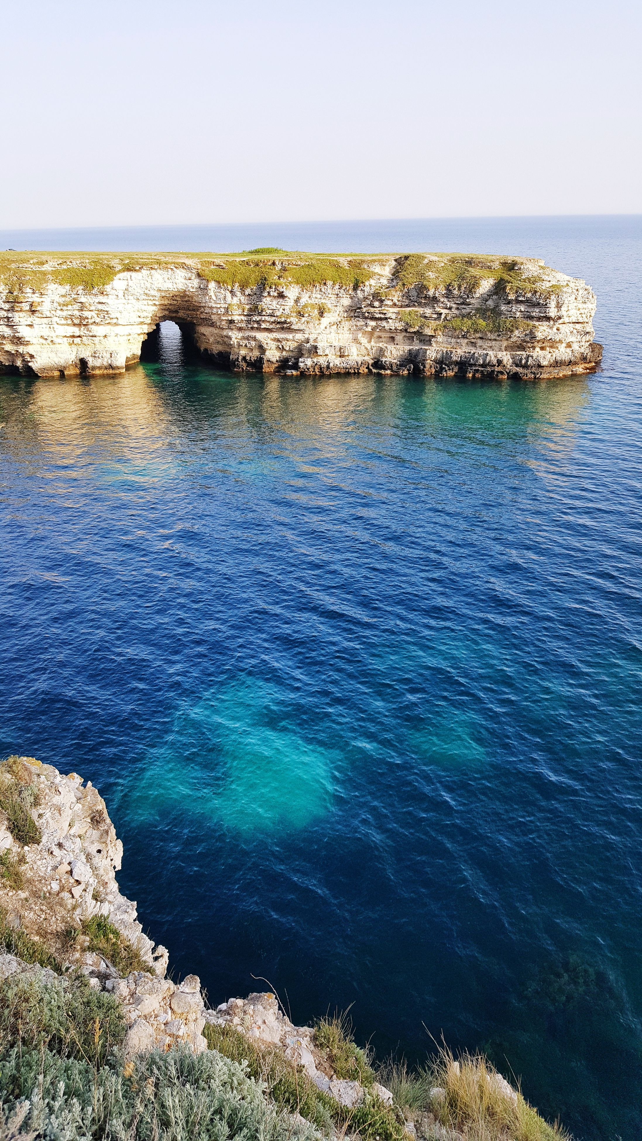 sea, rock - object, nature, water, beauty in nature, rock formation, scenics, tranquility, tranquil scene, idyllic, outdoors, day, no people, blue, clear sky, horizon over water, cliff, sky