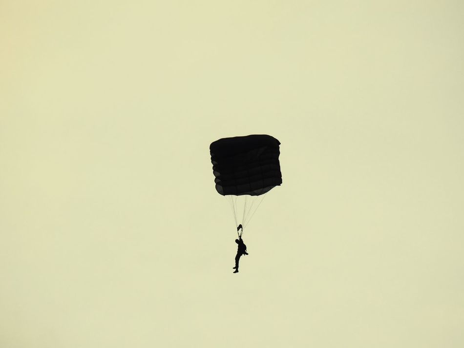 Solitary parachutist Parachute Parachutist One Person Silhouette Silhouettes Silhouette_collection Silhouette Photography Extreme Sports Real People Lifestyles Flying Fly Sport Sports Photography Solitary Sports Mid-air Paragliding Clear Sky Flying High Capture The Moment