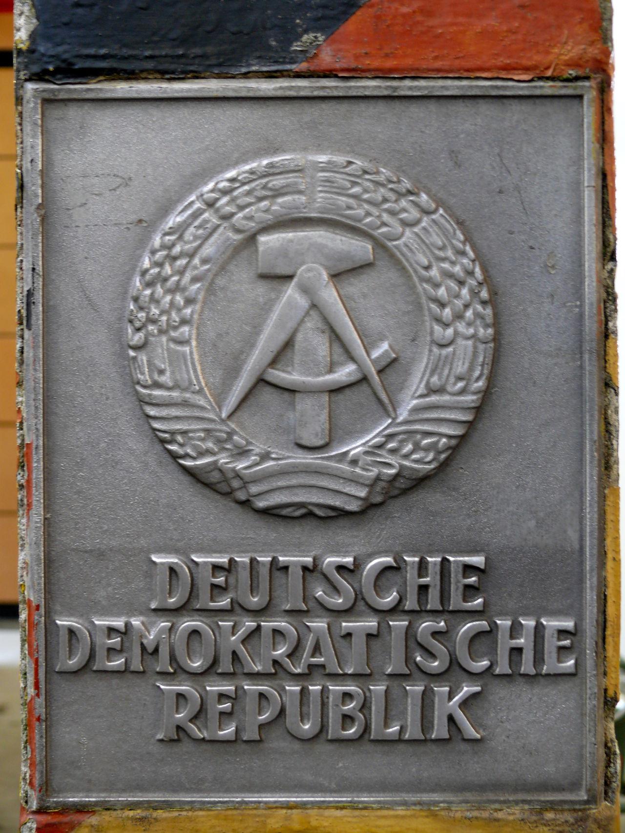 Capital Letter Close-up DDR DDR Grenze Hammer Und Zirkel Information Sign Metal No People Ostalgie Ostzonensuppenwürfelmachenkrebs Sign Text Western Script Zone