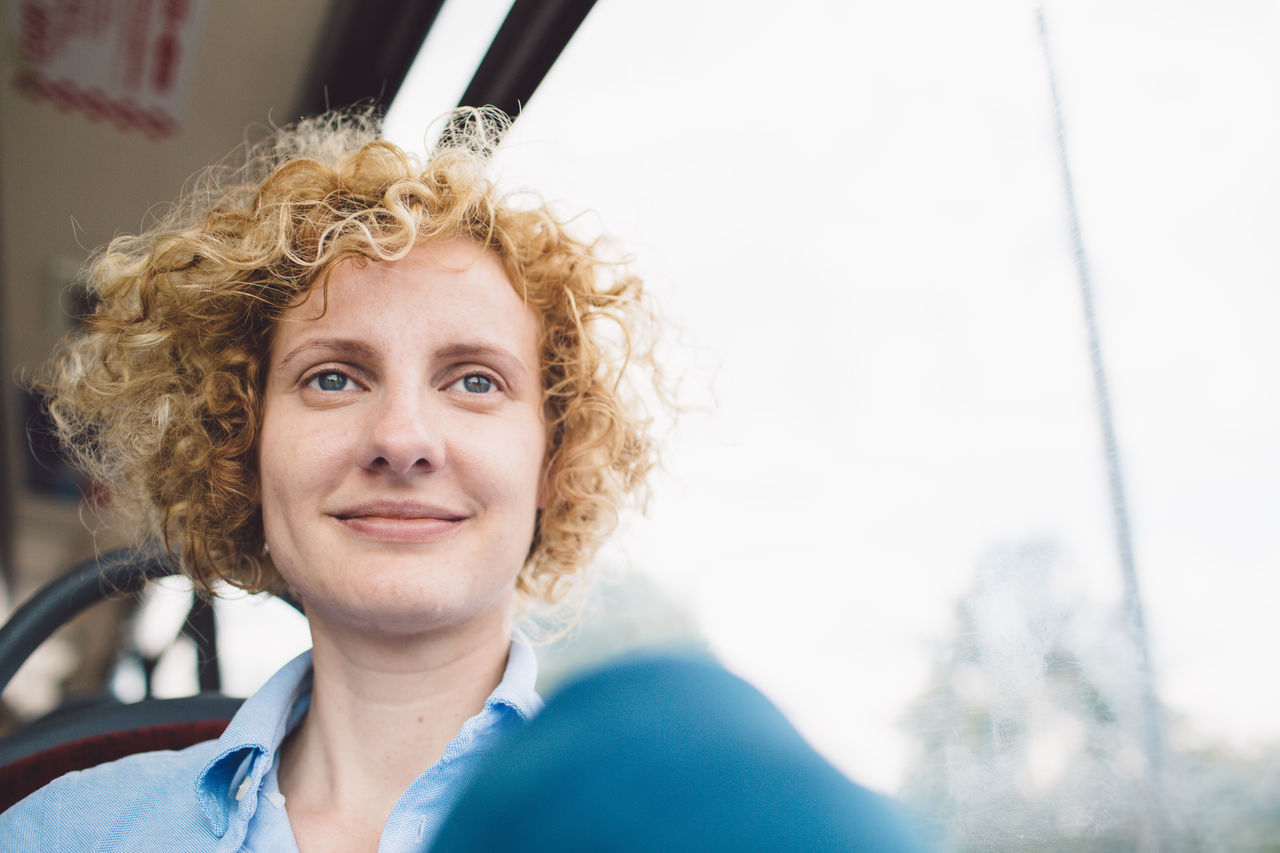 Adult Adults Only Beautiful Woman Blond Hair Close-up Curly Hair Day Girl Happiness Headshot London Bus Looking At Camera Medium-length Hair One Person One Woman Only Only Women Outdoors People Portrait Real People Smiling Women Young Adult Young Women