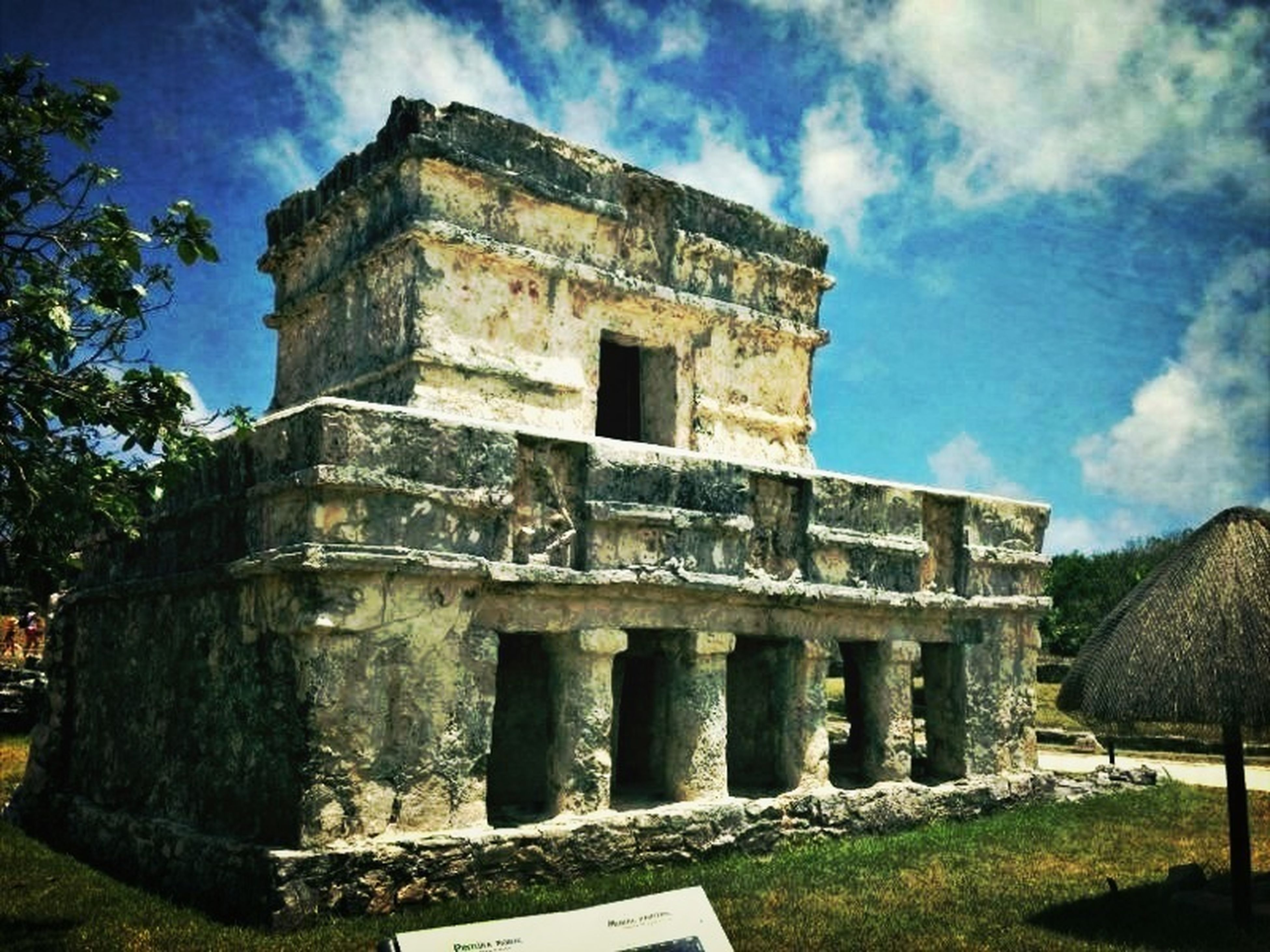architecture, built structure, sky, building exterior, history, old ruin, cloud - sky, the past, ancient, old, low angle view, cloud, stone wall, grass, abandoned, travel destinations, damaged, day, ancient civilization, famous place