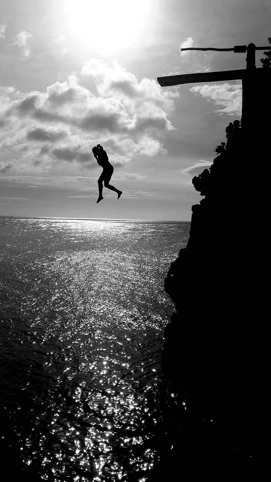 Cliff jumping in Boracay. Cloud - Sky Sea Sky Outdoors Beauty In Nature Horizon Over Water Day Water Nature People Sea Life Black And White Collection  Blackandwhite Photography Black And White Blackandwhite Travel Destinations Travel Check This Out Real People Motion Cliff Diving Cliffsandsea CliffJumping Boracay Island  Boracay Miles Away