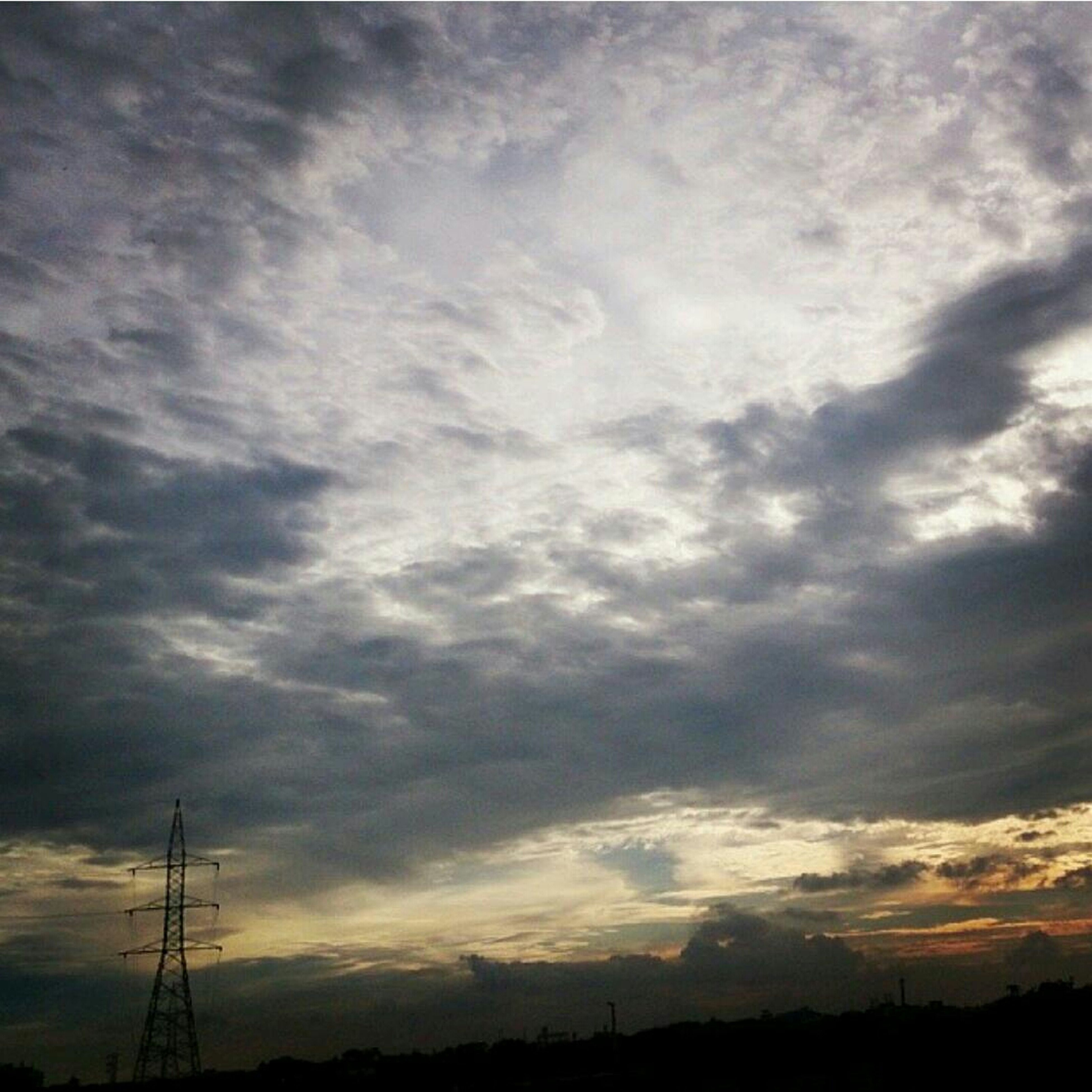 sky, silhouette, electricity pylon, power line, low angle view, sunset, cloud - sky, electricity, power supply, tranquility, scenics, beauty in nature, connection, cloudy, fuel and power generation, tranquil scene, cable, nature, technology, cloud